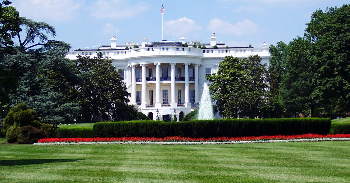 A large lawn in front of White House